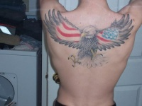Big flying eagle with flag usa on wings tattoo on back