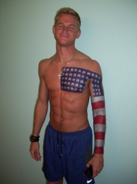 Cool american flag tattoo on chest and arm